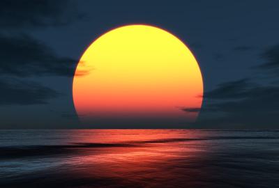 海に浮かぶ赤い満月